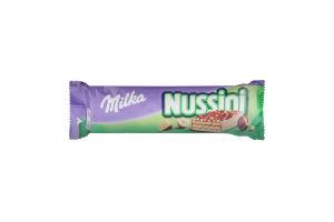 Вафля з фундуком і какао, посипана подрібненим фундуком і покрита молочним шоколадом Nussini Milka м/у 31.5г