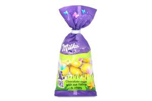 Шоколад молочний фігурний в формі яйця з горіховою начинкою з хрусткими пластівцями Milka м/у 100г