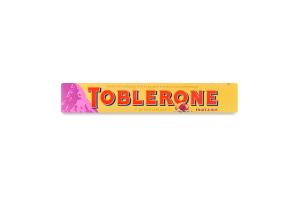 Шоколад Toblerone Молочний з родзинками та нугою 100г
