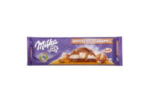 Шоколад з цілими лісовими горіхами, молочною та карамельною начинками Milka 300г