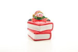 Підсвічник зі свічкою Сніговик на книзі Маг 2000 8*7 5*6 5см 2 в ас.790111