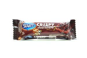 Батончик зерновой з хрустящими. какао-шариками и молочным шоколадом AXA25г